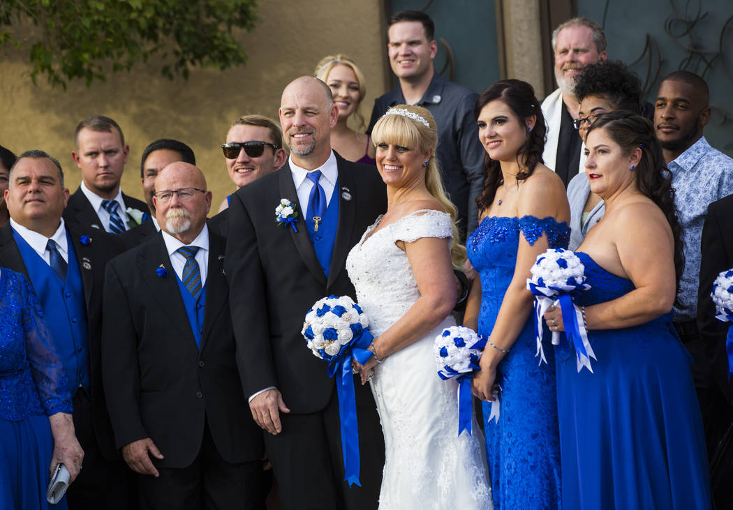 Todd Wienke and Oshia Wienke, center, pose for a group photo after their wedding ceremony at Chapel of the Flowers in Las Vegas on Monday, Oct. 1, 2018. Todd was shot three times as he shielded Os ...