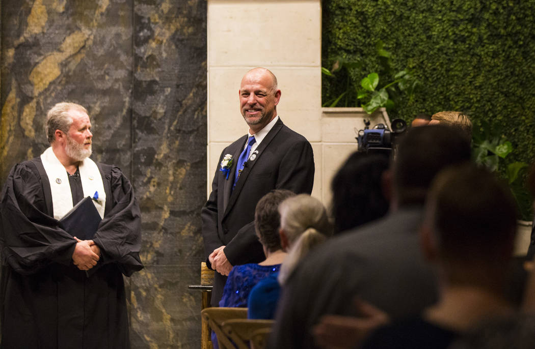 Todd Wienke looks on before the start of his wedding ceremony with Oshia Collins-Waters at Chapel of the Flowers in Las Vegas on Monday, Oct. 1, 2018. Todd was shot three times as he shielded Oshi ...