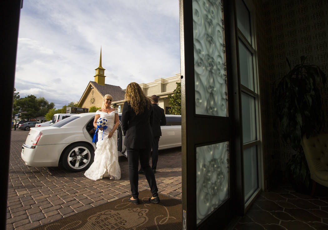 Oshia Collins-Waters arrives for her wedding ceremony with Todd Wienke at Chapel of the Flowers in Las Vegas on Monday, Oct. 1, 2018. Todd was shot three times as he shielded Oshia soon after the ...