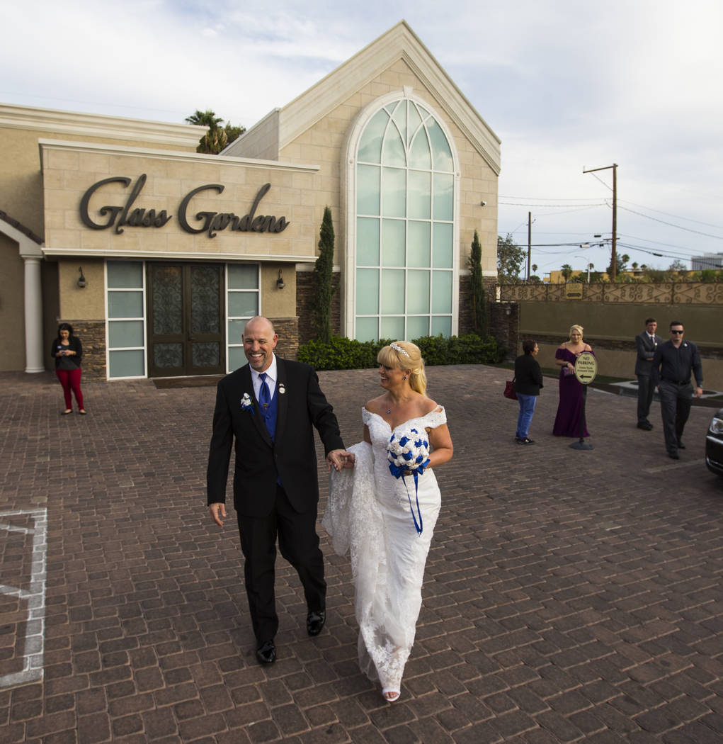 Todd Wienke and Oshia Wienke at the conclusion of their wedding ceremony at Chapel of the Flowers in Las Vegas on Monday, Oct. 1, 2018. Todd was shot three times as he shielded Oshia soon after th ...