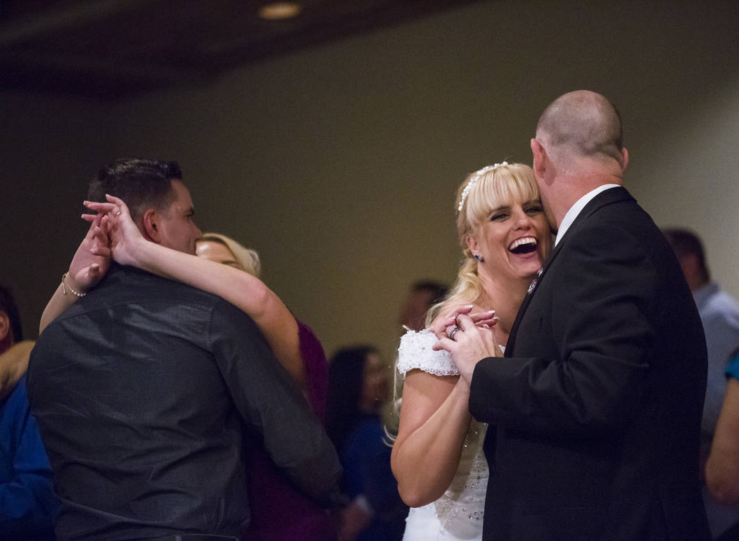 Todd and Oshia Wienke dance during their wedding reception at Tahiti Village in Las Vegas on Monday, Oct. 1, 2018. Todd was shot three times as he shielded Oshia soon after the shooting began the ...