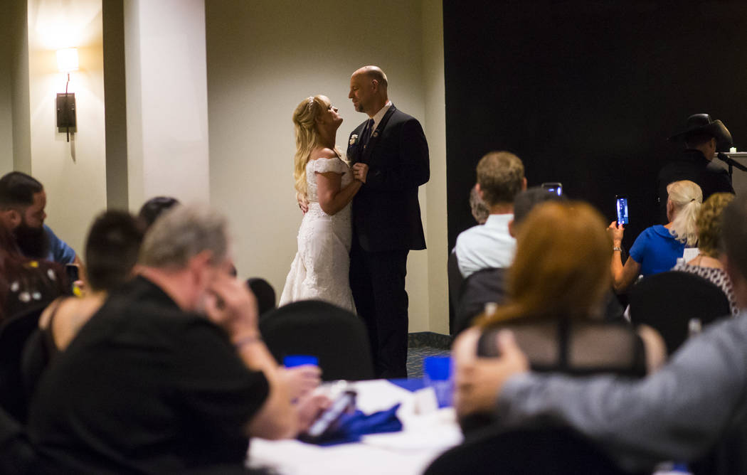 "Todd and Oshia Wienke dance to the song ""Vegas Strong"" by country musician Sam Riddle during their wedding reception at Tahiti Village in Las Vegas on Monday, Oct. 1, 2018. Todd was shot ..."
