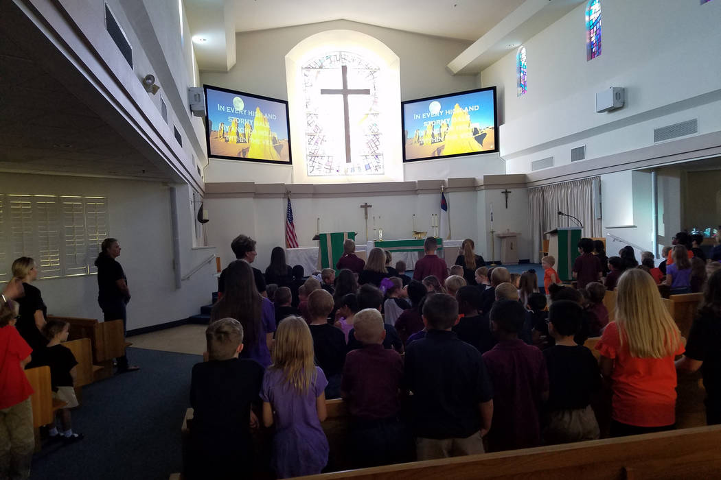 Students at Lamb of God Lutheran Elementary School sing and pray at a special chapel service Monday morning, Oct. 1, 2018, in observance of the 1 October shooting. (Richard N. Velotta/Las Vegas Re ...