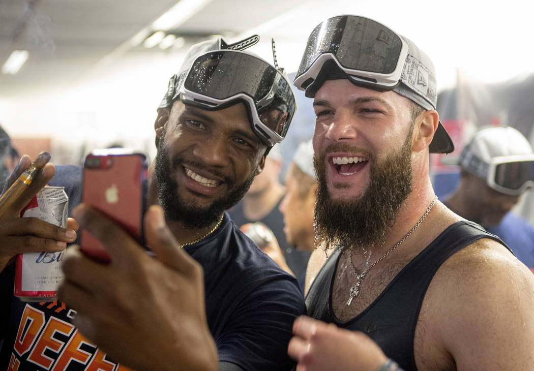 Houston Astros pitchers Dallas Keuchel, right, and Reymin Guduan celebrate in the locker room after a baseball game against the Toronto Blue Jays, Wednesday, Sept. 26, 2018 in Toronto. The World ...