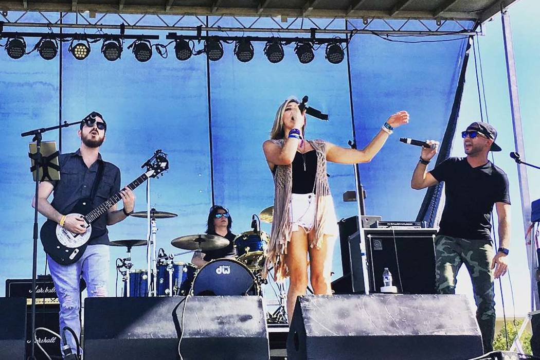 Jase Naron, Shon McKee, Ali Sekkat and Krystal Goddard perform at the Route 91 Reunion at Centennial Hills Park on Saturday, Sept. 29, 2018. (Amy McCaslin)