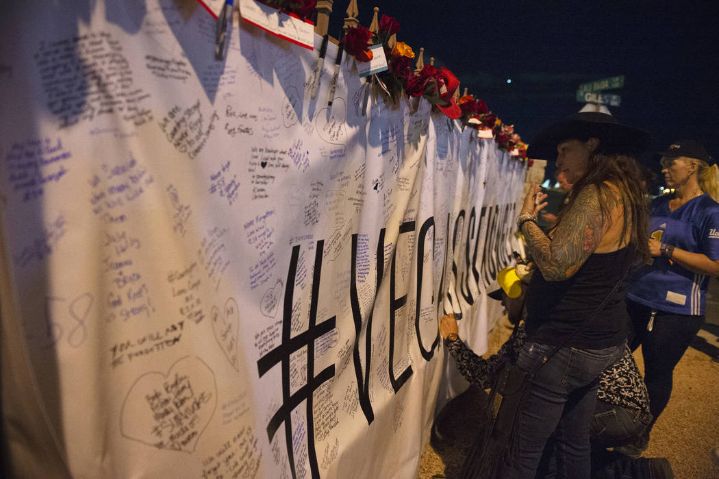 A #VegasStronger sign hangs outside of the lot where the One October shooting happened a year ago where members of the community are welcomed to write messages in Las Vegas, Monday, Oct. 1, 2018. ...