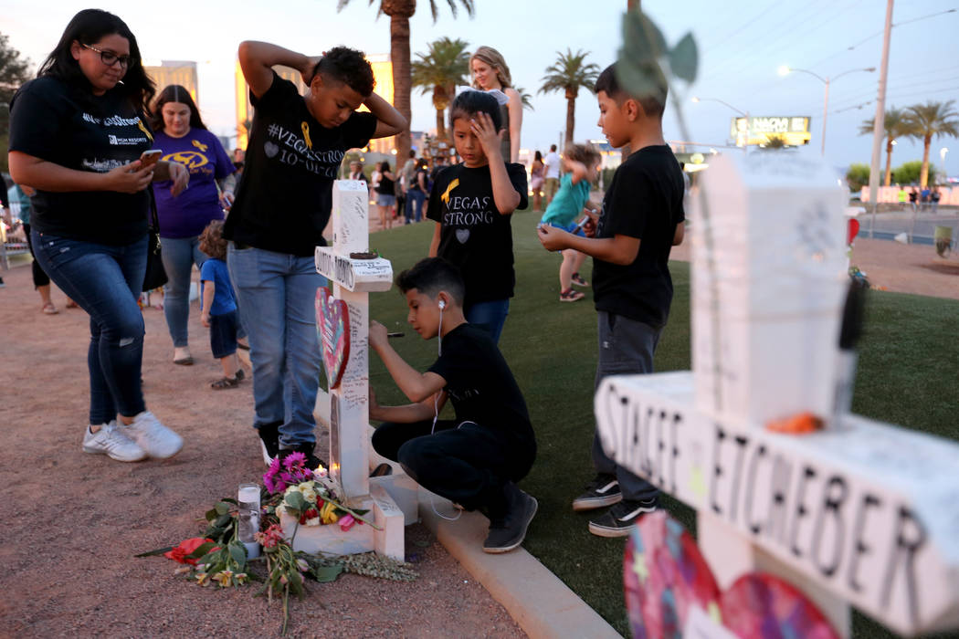 Fiorela Contreras, left, and her children, from left, Marcell, 11, Aaron, 9, Maki, 7, Ezekiel, 7, of Las Vegas at the Welcome to Fabulous Las Vegas sign on the one-year anniversary of the Oct. 1 ...