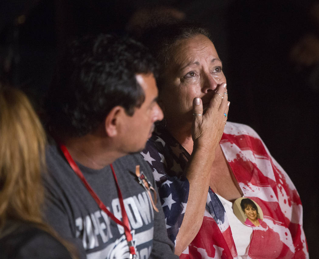 Family members of those killed in the Oct 1 shooting grieve while the names of their loved ones are read during a ceremony organized by the City of Las Vegas in conjunction with Get Outdoors Nevad ...