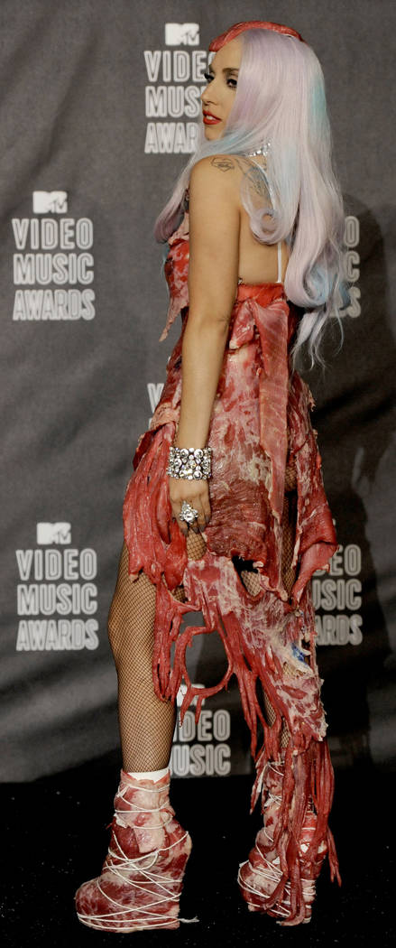 ** ADVANCE FOR USE THURSDAY, DEC. 23, 2010 AND THEREAFTER ** FILE - In this Sunday, Sept. 12, 2010 file picture, Lady Gaga, wearing raw meat, poses backstage after accepting the award for video o ...