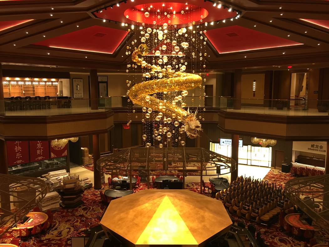 The Lucky Dragon's signature chandelier is seen inside its casino building on Monday, Oct. 1, 2018, the day before the resort's nine-story hotel tower was scheduled to close. (Eli Segall/Las Vegas ...