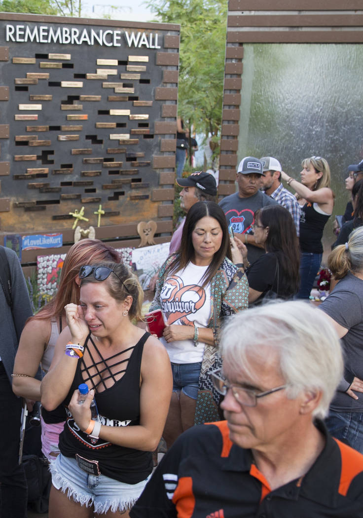 The Las Vegas Healing Garden was packed for the dedication of the new remembrance wall honoring victims of Oct 1 hosted by the City of Las Vegas in conjunction with Get Outdoors Nevada on Monday, ...