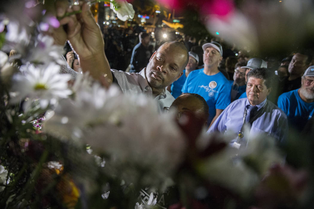Senator Aaron Ford (Democrat, Nevada) hangs a flower during the dedication of the new remembrance wall honoring victims of Oct 1 hosted by the City of Las Vegas in conjunction with Get Outdoors Ne ...