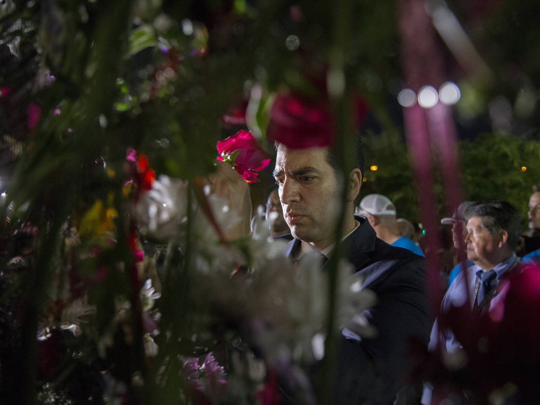 Representative Ruben Kihuen (D, Nevada) hangs a flower during the dedication of the new remembrance wall honoring victims of Oct 1 hosted by the City of Las Vegas in conjunction with Get Outdoors ...
