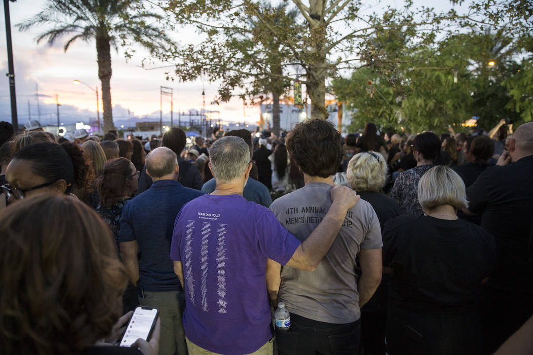 Attendees listen to a speaker during the dedication of the new remembrance wall honoring victims of Oct 1 hosted by the City of Las Vegas in conjunction with Get Outdoors Nevada on Monday, Oct. 1, ...