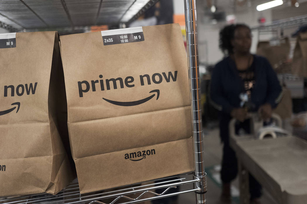 Prime Now customer orders are ready for delivery at the Amazon warehouse in New York, Dec. 20, 2017. (Mark Lennihan/AP, File)