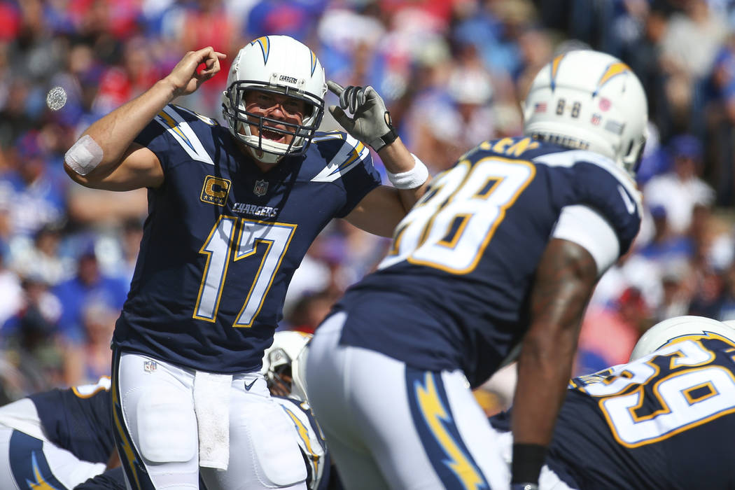 FILE - In this Sunday, Sept. 16, 2018, file photo, Los Angeles Chargers quarterback Philip Rivers (17) calls a play at the line during the first half of an NFL football game against the Buffalo Bi ...