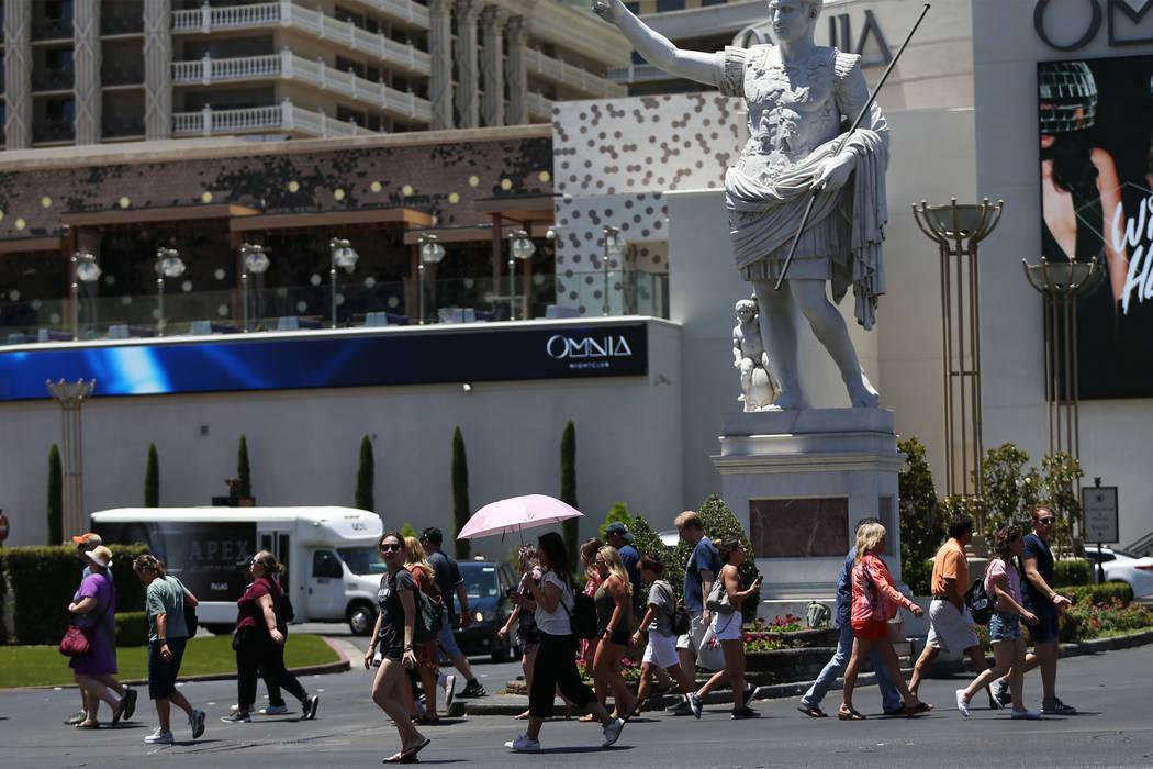 People walk on the Las Vegas Strip near Caesars Palace, Friday, June 22, 2018. Erik Verduzco Las Vegas Review-Journal @Erik_Verduzco