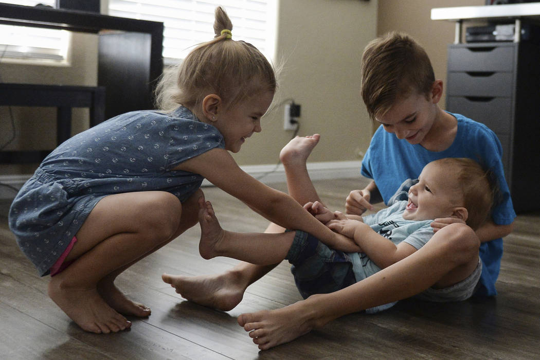 Lylah Matheson, 4, left, and Ryder Matheson, 8, tickle their younger brother, Wyatt Matheson, 1, in their home in Las Vegas, Sunday, Sept. 30, 2018. Caroline Brehman/Las Vegas Review-Journal