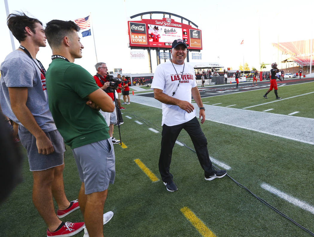 UNLV Rebels head coach Tony Sanchez greets supporters on the sideline before the start of a football game against Prairie View A&M Panthers at Sam Boyd Stadium in Las Vegas on Saturday, Sept. ...