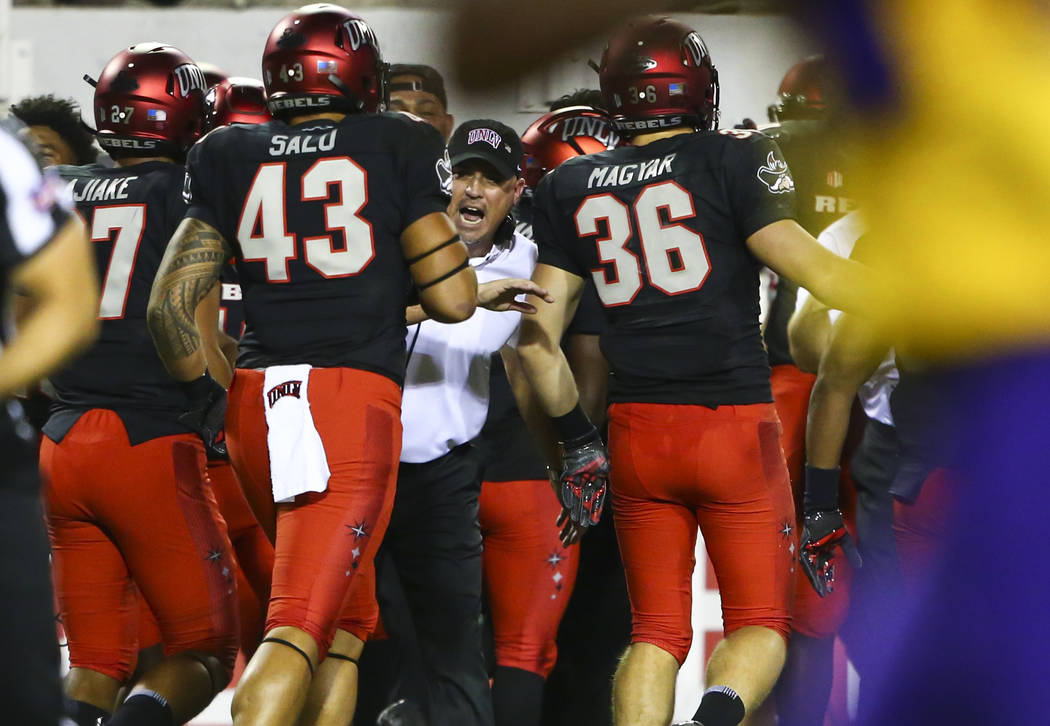 UNLV Rebels head coach Tony Sanchez celebrates a touchdown with his team during the first half of a football game against the Prairie View A&M Panthers at Sam Boyd Stadium in Las Vegas on Sat ...