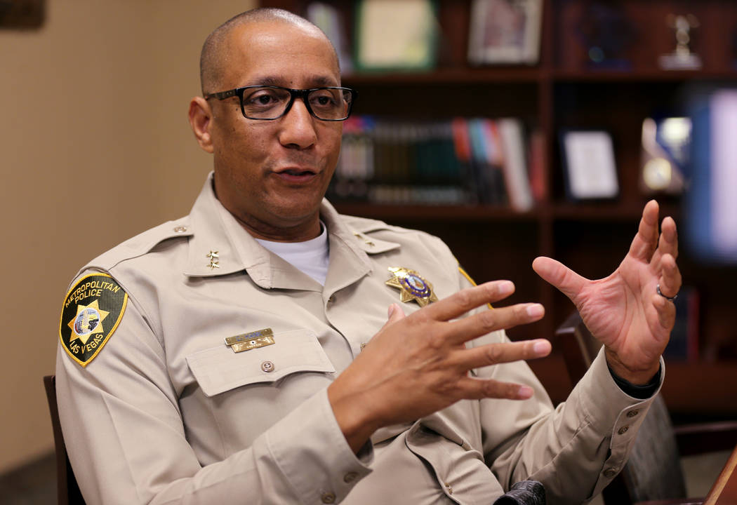 Assistant Sheriff Charles Hank talks to a reporter at Metropolitan Police Headquarters in Las Vegas Tuesday, Oct. 2, 2018, about changes the department has made in the wake of the of the Oct. 1 St ...