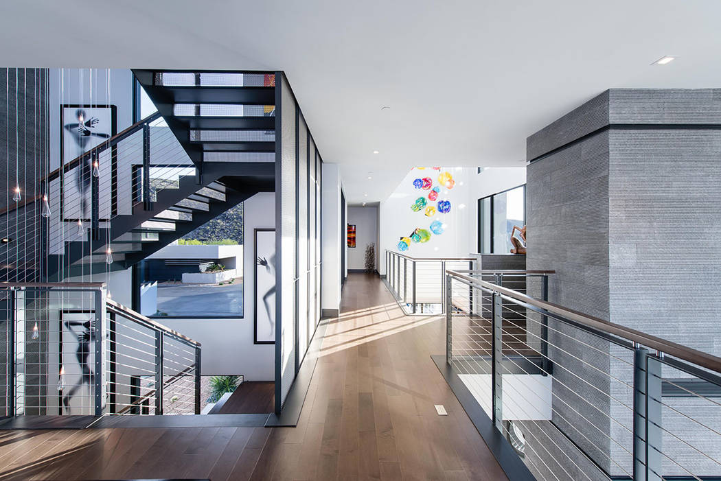 The home features a custom staircase. (Simply Vegas)