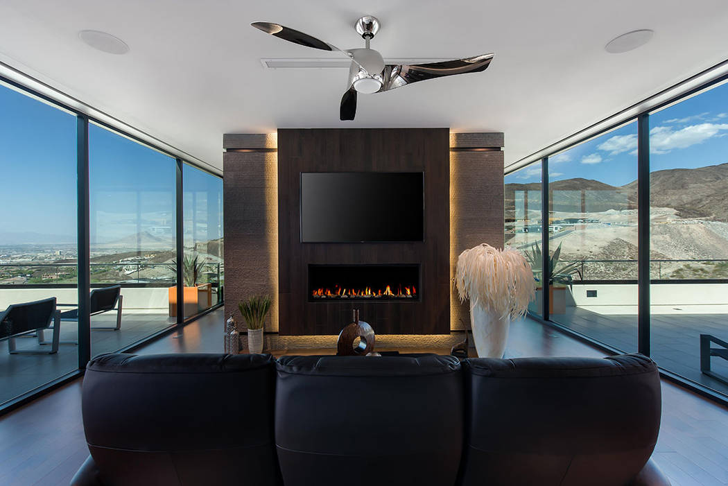The master suite features a modern gas fireplace and sitting area. (Simply Vegas)
