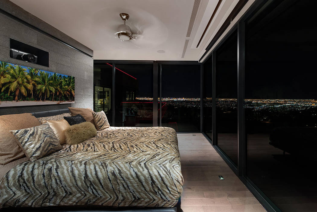 The master bedroom's floor-to-ceiling windows offer a sweeping view of the Las Vegas lights. (Simply Vegas)