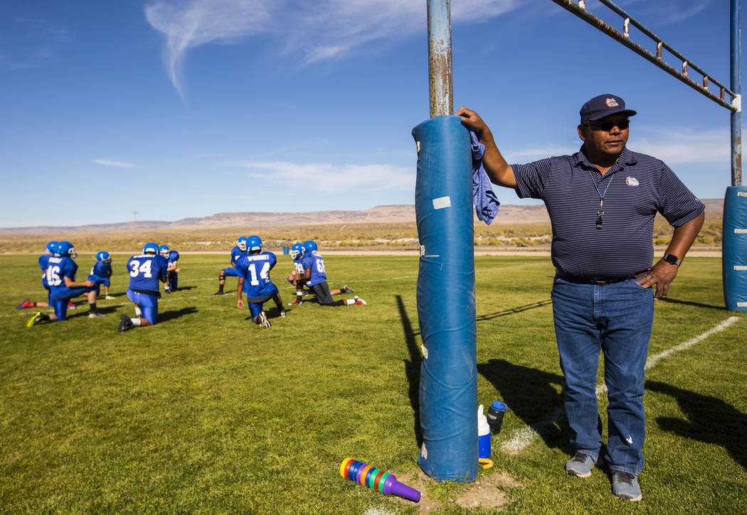 McDermitt football coach Richard Egan, right, looks on as his players stretch during practice at McDermitt High School in McDermitt on Tuesday, Sept. 25, 2018. Chase Stevens Las Vegas Review-Journ ...