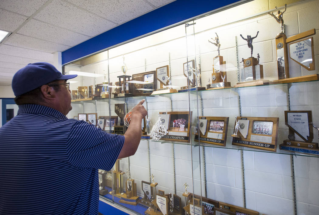 McDermitt football coach Richard Egan points to the state championship trophy he helped the team win as a player in 1982 at the high school in McDermitt on Tuesday, Sept. 25, 2018. Chase Stevens L ...