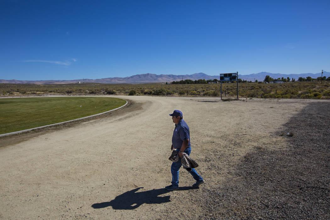 McDermitt football coach Richard Egan walks onto the field before practice at the high school in McDermitt on Tuesday, Sept. 25, 2018. Chase Stevens Las Vegas Review-Journal @csstevensphoto
