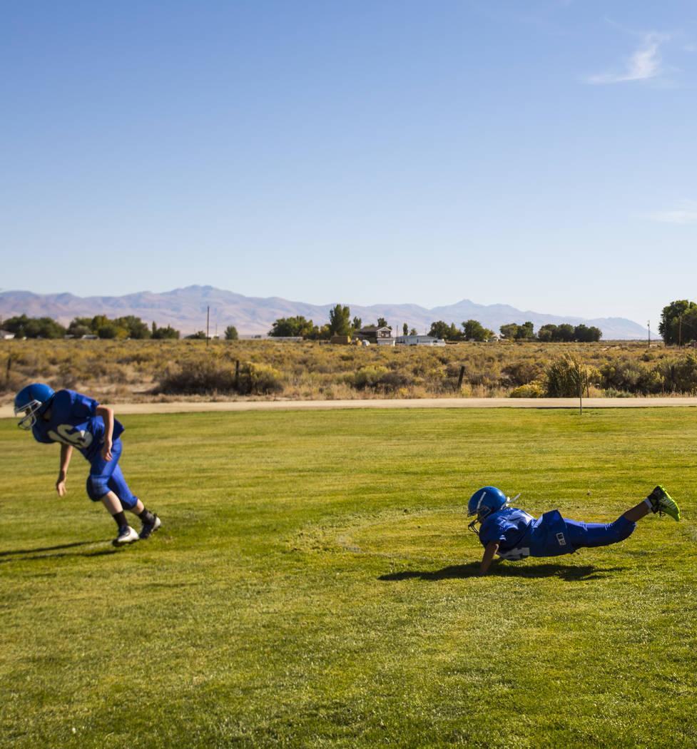 Football run through drills during practice at McDermitt High School in McDermitt on Tuesday, Sept. 25, 2018. Chase Stevens Las Vegas Review-Journal @csstevensphoto