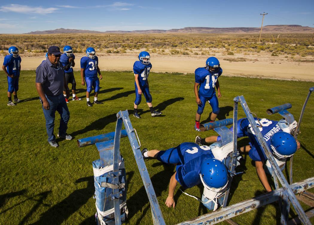 Football coach Richard Egan, left, leads practice as players run through drills at McDermitt High School in McDermitt on Tuesday, Sept. 25, 2018. Chase Stevens Las Vegas Review-Journal @csstevensphoto