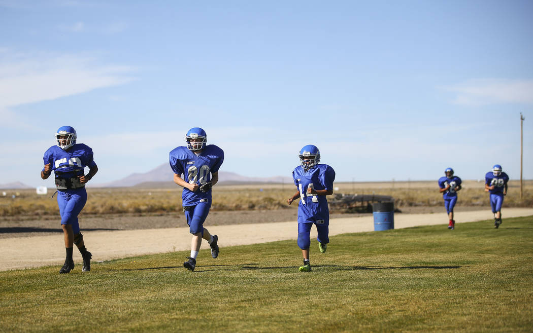 Football players run laps during practice at McDermitt High School in McDermitt on Tuesday, Sept. 25, 2018. Chase Stevens Las Vegas Review-Journal @csstevensphoto