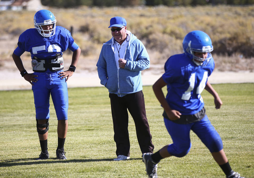 Quarterback Jagger Hinkey, left, talks with assistant football coach Jack Smith during practice at McDermitt High School in McDermitt on Tuesday, Sept. 25, 2018. Chase Stevens Las Vegas Review-Jou ...