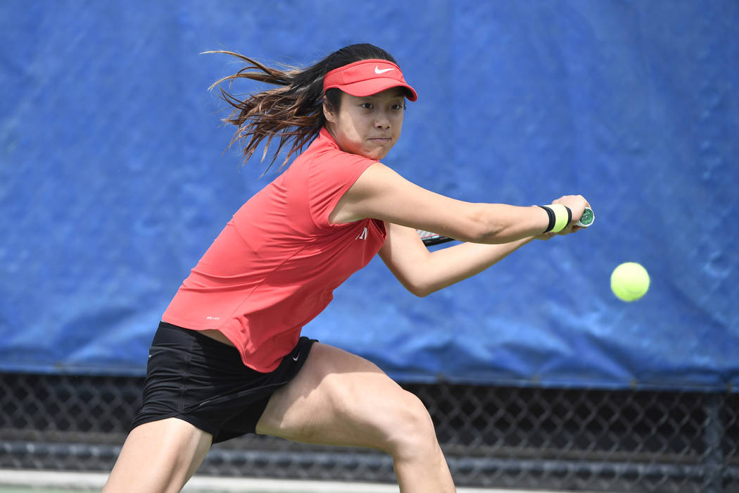 UNLV junior Aiwen Zhu prepares to return a shot to Fresno State junior Emma Wilson during Zhu's 7-6 (5), 6-2 victory Sunday in the Mountain West championship title match in Boise, Idaho. (Tim Nwac ...