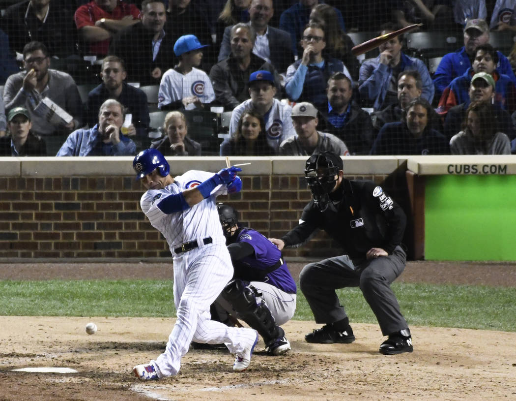 Chicago Cubs' Willson Contreras (40) breaks his bat as he grounds out against the Colorado Rockies during the fifth inning of the National League wild-card playoff baseball game, Tuesday, OCT. 2, ...