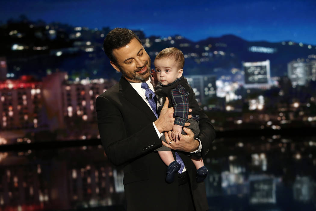 "Jimmy Kimmel holds his son, Billy, during the ""Jimmy Kimmel Live!"" show. (ABC/Randy Holmes)"
