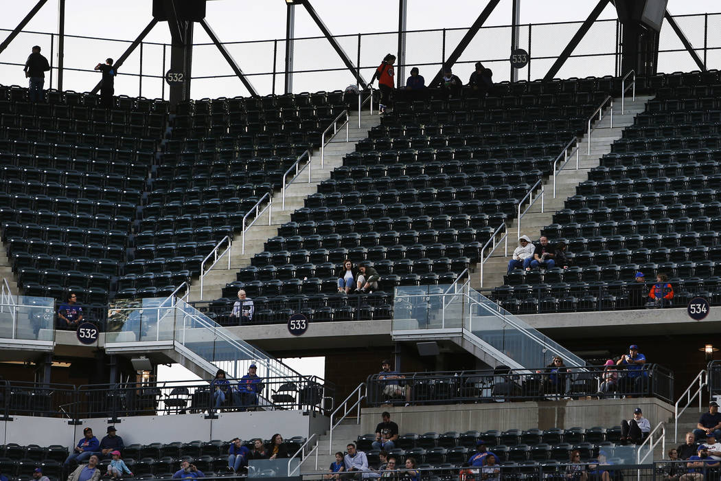 Empty seats are seen during a baseball game between the New York Mets and Miami Marlins at Citi Field, in New York on Sept. 30, 2018. Major League Baseball's attendance dropped to its lowest level ...