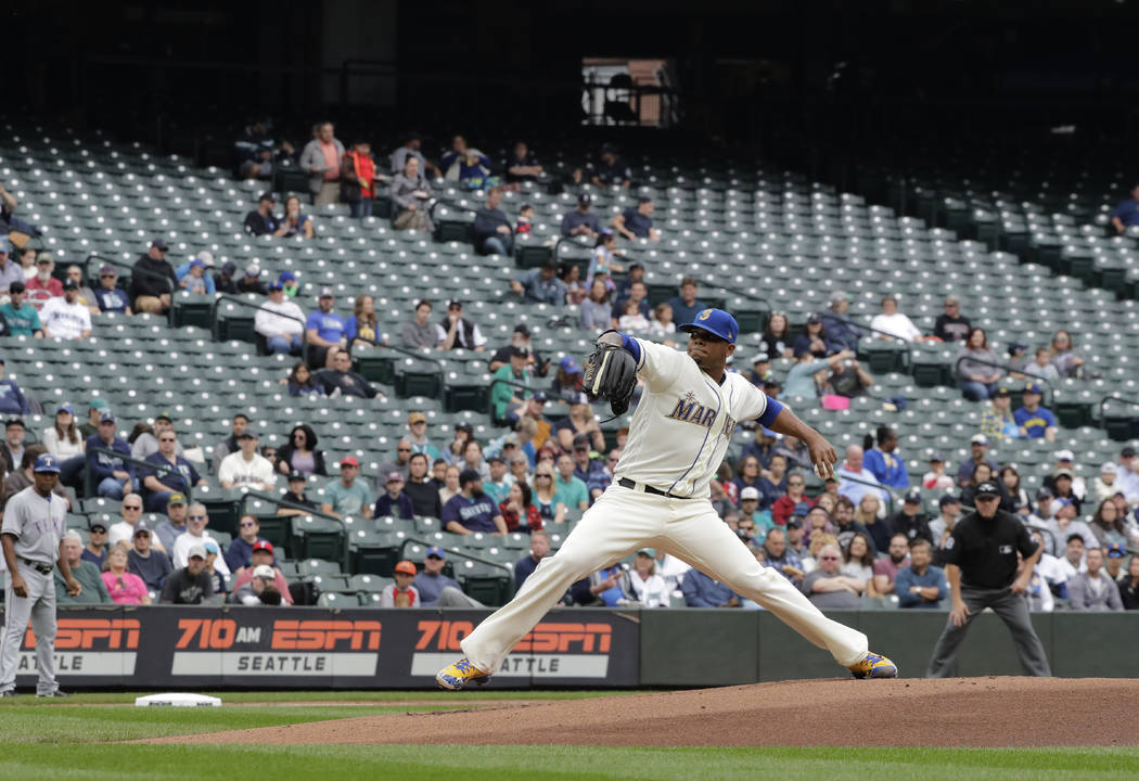Empty seats are shown at Safeco Field as Seattle Mariners starting pitcher Roenis Elias throws against the Texas Rangers during the first inning of a baseball game, in Seattle on Sept. 30, 2018. M ...