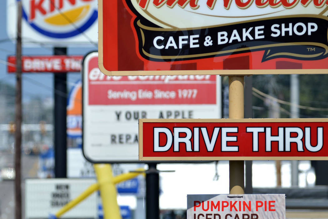 Fast food restaurant signs line Peach Street in Erie, Pa. on Tuesday, Aug. 26, 2014. A Centers for Disease Control and Prevention study released on Wednesday, Oct. 3, 2018 finds that one in three ...