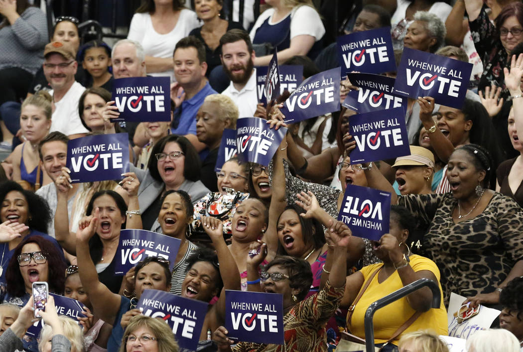 Rally attendees cheer as former first lady Michelle Obama speaks during a voter registration rally on Sunday, Sept. 23, 2018, in Las Vegas. Obama pushes to increase voter registration and engageme ...