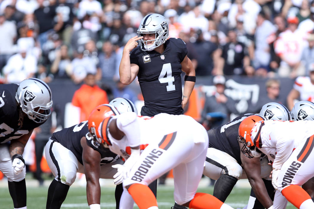 Oakland Raiders quarterback Derek Carr (4) gestures to the offense at the line of scrimmage during the first half of their NFL game against the Cleveland Browns in Oakland, Calif., Sunday, Sept. 3 ...