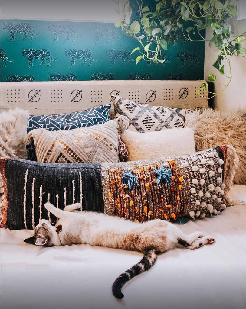 These hand-woven pillows from Anthropologie add texture and color to the bedroom. (Anthropologie)