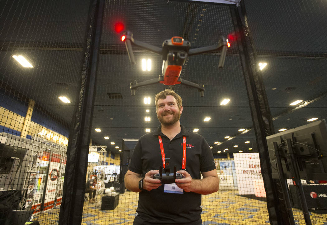 Andrew St. Pierre of Autel Robotics demos the Evo camera drone during the third annual Commercial UAV Expo at the Westgate in Las Vegas on Wednesday, Oct. 3, 2018. Richard Brian Las Vegas Review-J ...