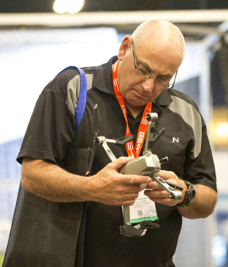 Attendee Matthew Waldon of Australia inspects a DJI Mavic drone on display at the Drone Nerds booth during the third annual Commercial UAV Expo at the Westgate in Las Vegas on Wednesday, Oct. 3, 2 ...
