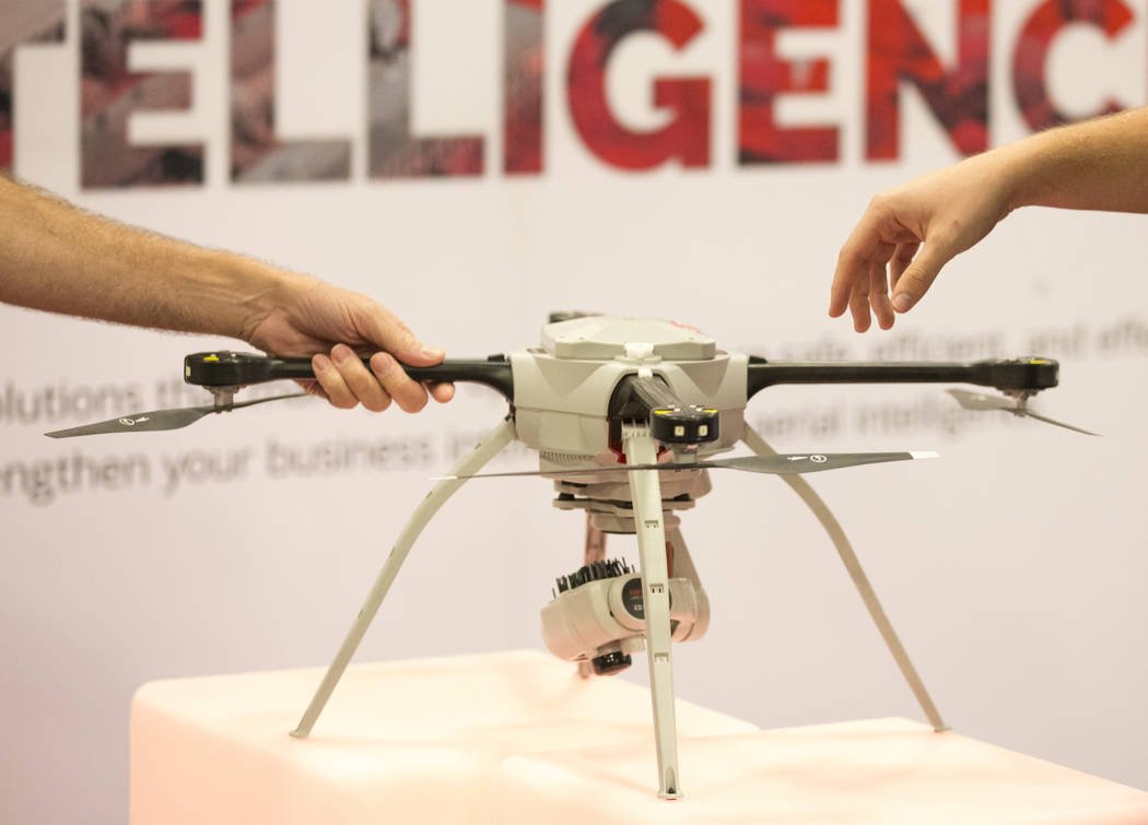 Attendees inspect the SkyRanger drone by Aeryon on display at the Precision Hawk booth during the third annual Commercial UAV Expo at the Westgate in Las Vegas on Wednesday, Oct. 3, 2018. Richard ...