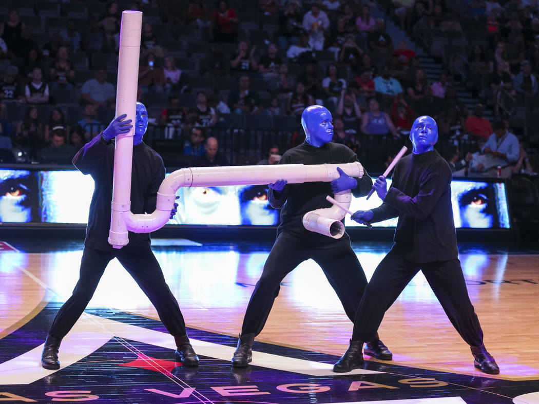 Blue Man Group take part in a half time performance at center-court during the Las Vegas Aces and Indiana Fever WNBA basketball game at the Mandalay Bay Events Center in Las Vegas on Sunday, July ...