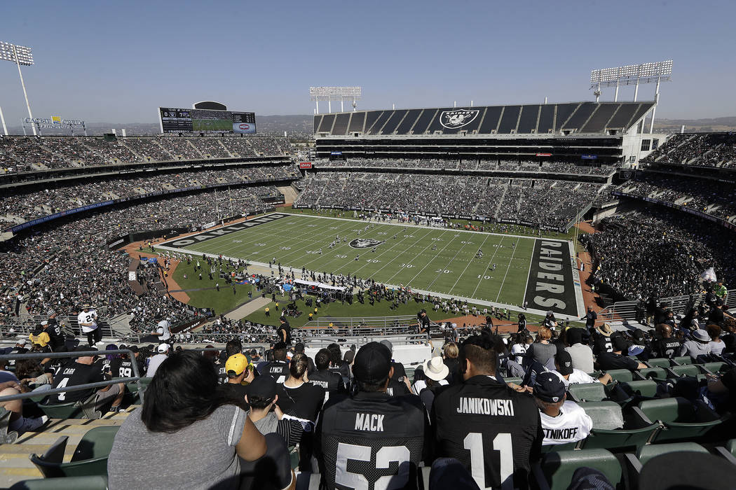 Fans watch from a general view at Oakland Alameda County Coliseum during the first half of an NFL football game between the Oakland Raiders and the Baltimore Ravens in Oakland, Calif., Sunday, Oct ...