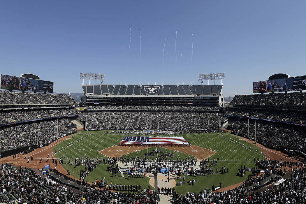 A flag is presented at Oakland Alameda County Coliseum during the performance of the national anthem before an NFL football game between the Oakland Raiders and the New York Jets in Oakland, Calif ...